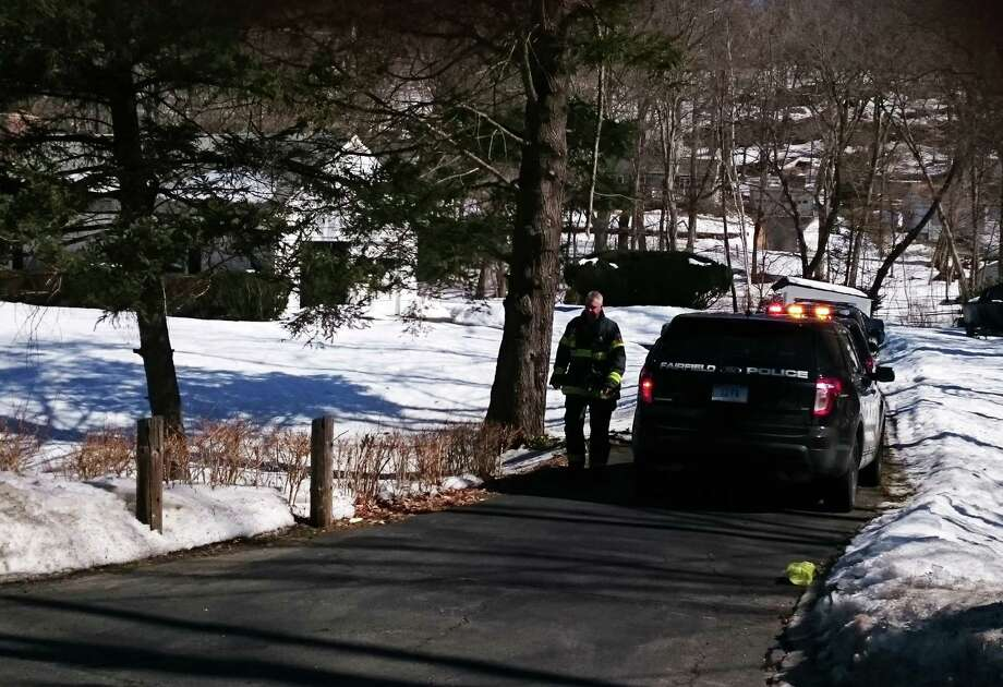 A man was trapped briefly under his truck as he worked on the vehicle Thursday at his Black Rock Turnpike home, prompting emergency crews to be dispatched to the site. Photo: Genevieve Reilly / Fairfield Citizen