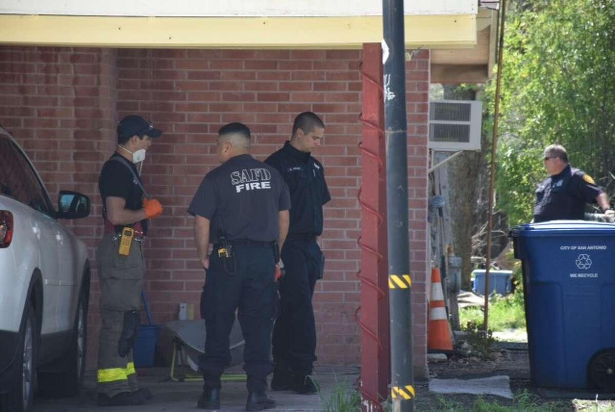 Police investigate a dead body found in a chimney.