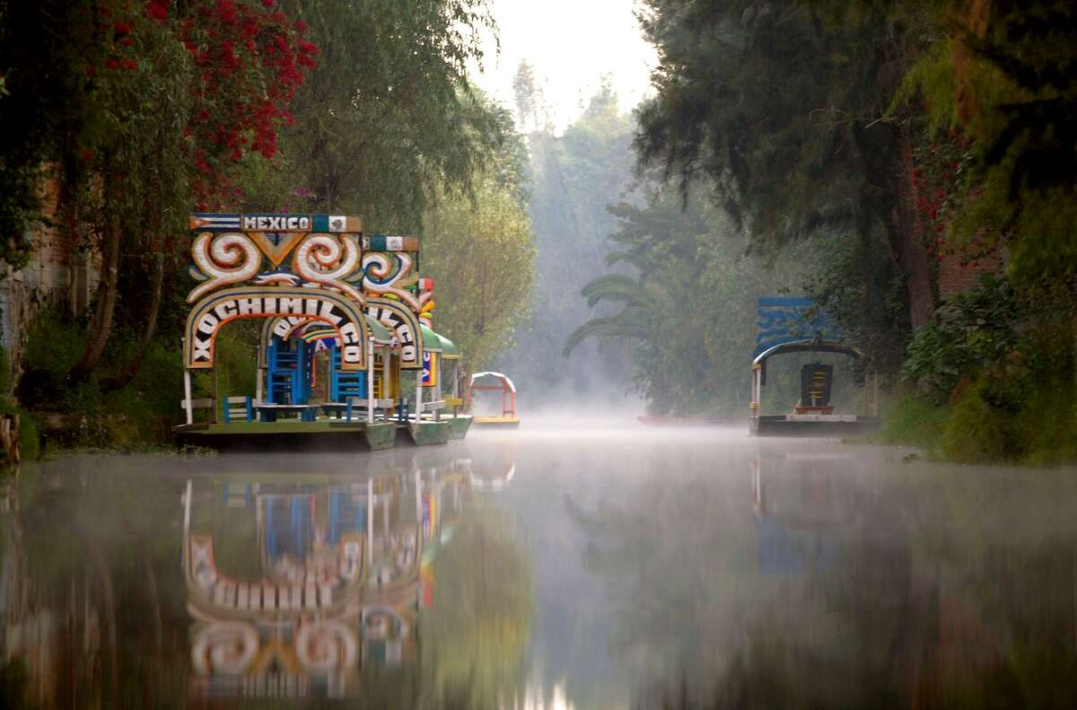 One of the capital's most cherished Sunday traditions is spending an afternoon floating through the canals on brightly painted, covered wooden pole boats called trajineras, having a long lunch and enjoying mariachis playing on passing barges.