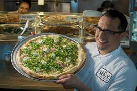 Owner Jon Kosorek with the White Pie at Buma's Pizzeria in Oakland, Calif. is seen on March 10th, 2015.