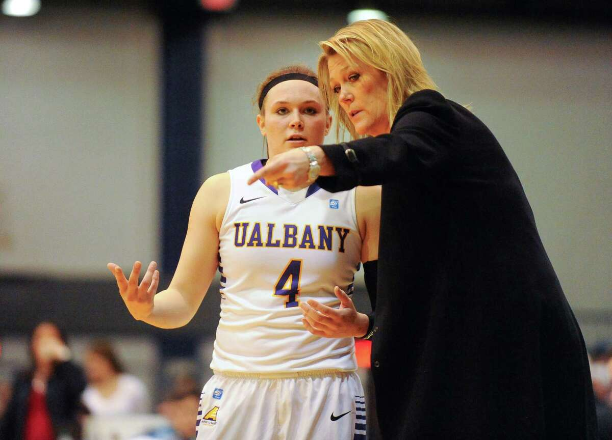 UAlbany head coach Katie Abrahamson-HendersonÊinstructs SarahRoyals (4) against Hartford's during the second half of an NCAA college basketball game at the SEFCU Arena in Albany, N.Y., Sunday, Jan. 25, 2015. (Hans Pennink / Special to the Times Union) ORG XMIT: HP106