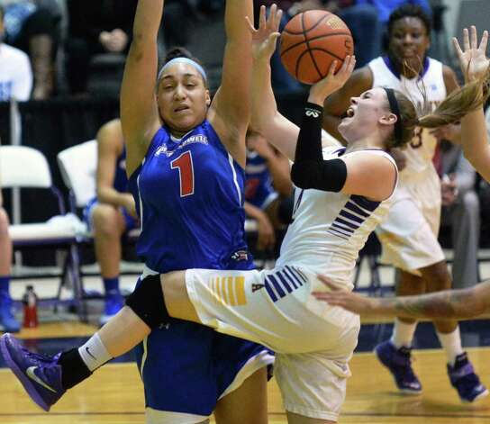 UAlbany's #4 Sarah Royals, right, is fouled by UMass-Lowell's #1 Kayla Gibbs during Saturday's game at the SEFCU Arena Feb. 7, 2015, in Albany, NY.  (John Carl D'Annibale / Times Union) Photo: John Carl D'Annibale / 10030492A