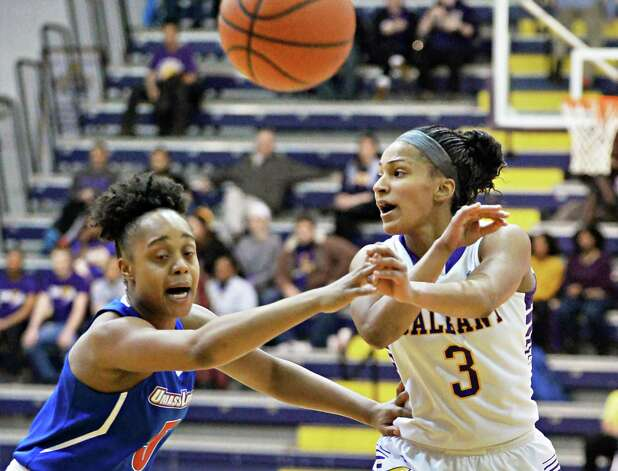 UAlbany's #3, Margarita Rosario, right, gets a pass around UMass-Lowell's #5 Jontay Walton during Saturday's game at the SEFCU Arena Feb. 7, 2015, in Albany, NY.  (John Carl D'Annibale / Times Union) Photo: John Carl D'Annibale / 10030492A