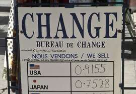 An exchange rate board in Paris, Friday, March 6, 2015. The euro could soon be doing something it's only done a couple of times in its 16-year existence, trading 1-to-1 with the dollar. Europe's single currency has since May been on a downward trajectory again the dollar, mainly because of the divergence in economic performance between the eurozone an the United States. (AP Photo/Michel Euler)