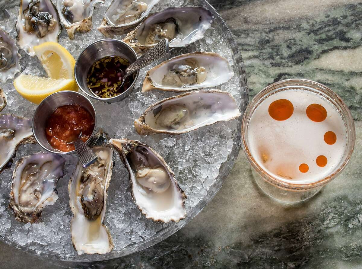 """The """"Salt and Smoke"""" cocktail with a platter of Oysters at Benjamin Cooper in San Francisco, Calif. is seen on March 10th, 2015."""