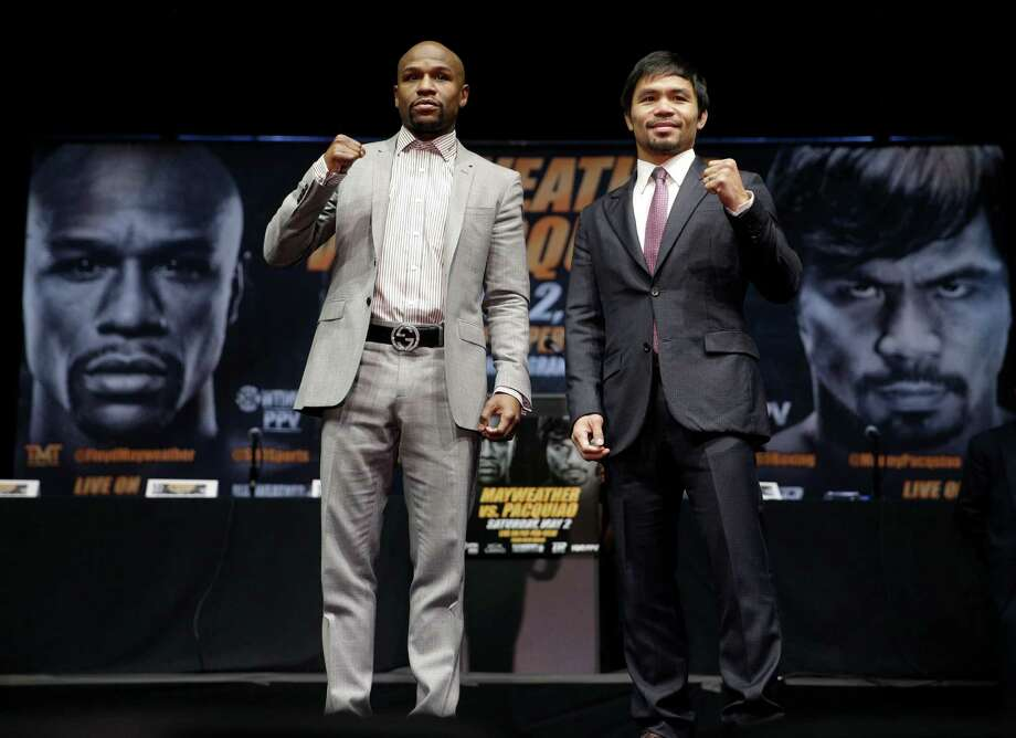 Floyd Mayweather Jr. (left) and Manny Pacquiao pose for photos after a news conference on March 11, 2015, in Los Angeles. The two are scheduled to fight in Las Vegas on May 2. Photo: Jae C. Hong /Associated Press / AP