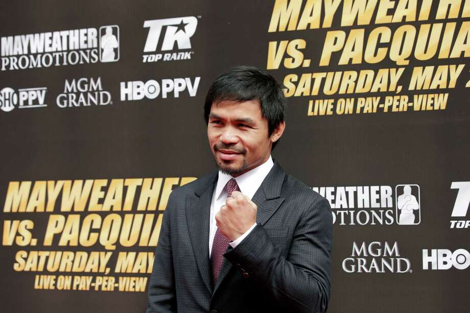 Boxing fanCalaway also happens to be a boxing fan. When Manny Pacquiao fought Hector Velazques in 2005, Calaway accompanied Pacquiao's posse to the ring.Source: YouTube (Appears clearly at 4:16) Photo: Jae C. Hong /Associated Press / AP