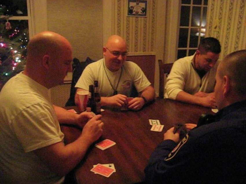 Former Albany police officer Robert Schunk, second from left, playing cards with several police officers. Schunk was the target of numerous internal investigations during his police career, including allegations that officers met at his house while on duty to play cards and drink beer.