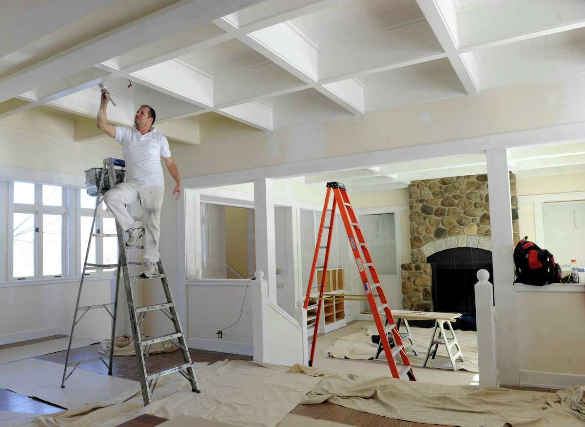 Gabriel Orozco, paints the ceiling in a room off the kitchen of a home undergoing extensive updating. This estate on Giles Road in Redding, Conn. is on the market for $19,500 million. The 19,000 square foot home includes grounds with more than 300 acres. Thursday, March 12, 2015.