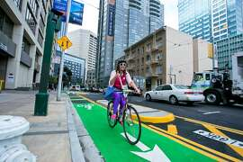Meghan Arnold rides along the protected bike lane on Polk Street during Bike to Work Day 2014. Photo by Russell Edwards