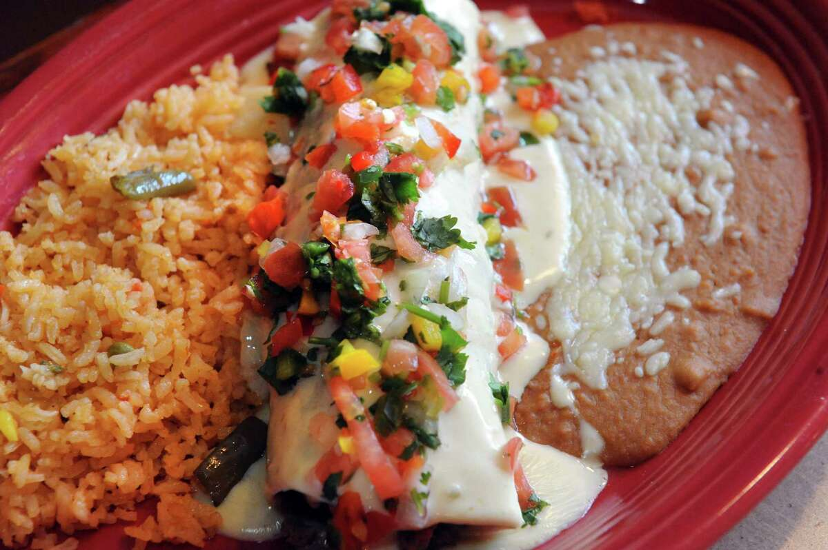 The burrito California, grilled steak or chicken cooked with onions and tomatoes and covered with melted cheese at El Charro restaurant on Friday, March 6, 2015, in Latham, N.Y. (Michael P. Farrell/Times Union)