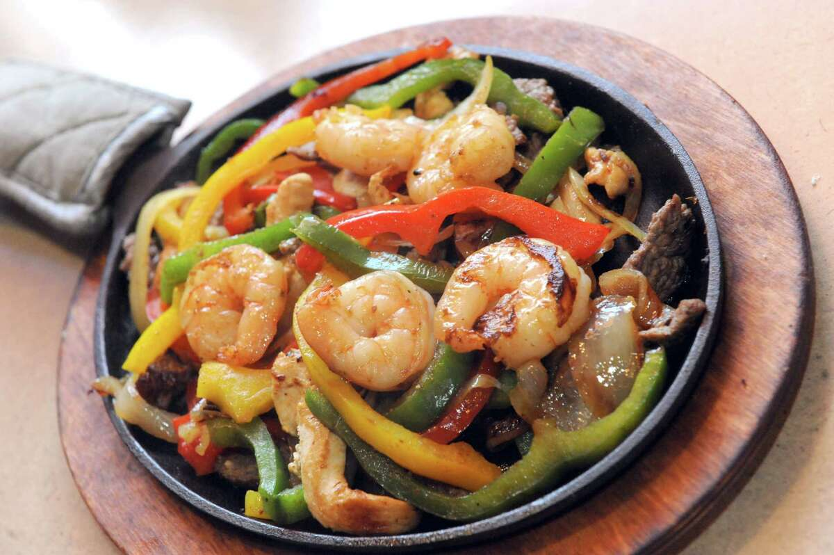 Fajitas Texanas, tender sliced steak, chicken and shrimp grilled with green, yellow and red peppers, onions and tomatoes at El Charro restaurant on Friday, March 6, 2015, in Latham, N.Y. (Michael P. Farrell/Times Union)