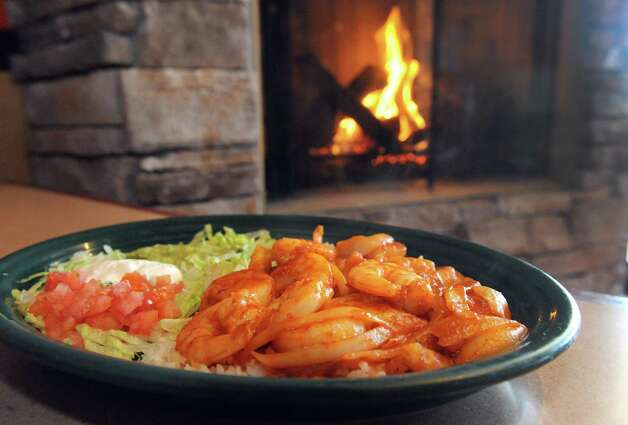 Camarones a la diabla, marinated shrimp grilled with onions and a very hot, spicy sauce at El Charrol restaurant on Friday March 6, 2015 in Latham, N.Y.  (Michael P. Farrell/Times Union) ORG XMIT: MER2015030617115789 Photo: Michael P. Farrell / 00030900A