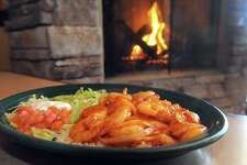 Camarones a la diabla, marinated shrimp grilled with onions and a very hot, spicy sauce at El Charro restaurant on Friday March 6, 2015 in Latham, N.Y. (Michael P. Farrell/Times Union)