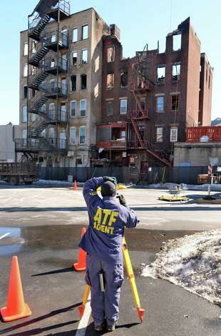 An ATF agent on the scene of the Jay Street fatal fire Thursday March 12, 2015 in Schenectady, NY.  (John Carl D'Annibale / Times Union) Photo: John Carl D'Annibale / 00030996A