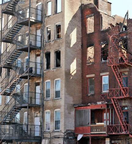 Skeletons of buildings at the scene of the Jay Street fatal fire Thursday March 12, 2015 in Schenectady, NY.  (John Carl D'Annibale / Times Union) Photo: John Carl D'Annibale / 00030996A