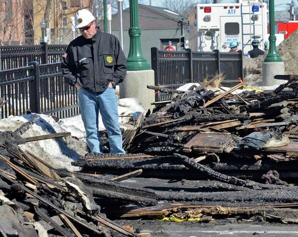 Chief building inspredtor Eric Shilling looks through rubble at the scene of the Jay Street fatal fire Thursday March 12, 2015 in Schenectady, NY.  (John Carl D'Annibale / Times Union) Photo: John Carl D'Annibale / 00030996A