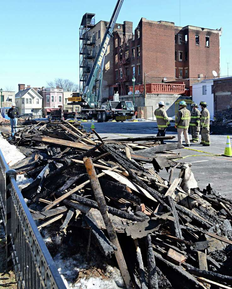 Firefighters on the scene of the Jay Street fatal fire Thursday March 12, 2015 in Schenectady, NY.  (John Carl D'Annibale / Times Union) Photo: John Carl D'Annibale / 00030996A