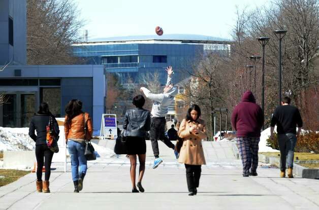 UAlbany students make their way to and from classes on Thursday March 12, 2015 in Albany, N.Y. The university's spring brak break begins Saturday.  (Michael P. Farrell/Times Union) Photo: Michael P. Farrell