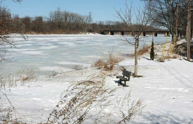 Ice on the Mohawk River near the Stockade awaits a spring thaw on Thursday, March 12, 2015 in Schenectady, N.Y. If the ice melts too fast, it could lead to flooding. (Lori Van Buren / Times Union) Photo: Lori Van Buren / 00031003A