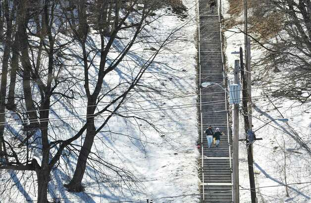 Sharena Ware and her daughter Ameerah Turner, 8, of Albany make their way down the long flight of stairs that lead from Elk St. down to Sheridan Ave. on Thursday, March 12, 2015, in Albany, N.Y.   (Paul Buckowski / Times Union) Photo: LORI VAN BUREN / 00031003A