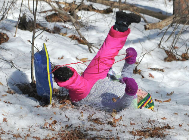 Alma Salmon, 11, of Niskayuna hits a patch of leaves flips while sledding on hill near Central Park on Thursday, March 12, 2015 in Schenectady, N.Y.  (Lori Van Buren / Times Union) Photo: Lori Van Buren / 00031003A