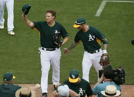 Actor Will Ferrell, left, tips his cap after playing shortstop for the Oakland Athletics during the first inning of a spring training baseball game against the Seattle Mariners, Thursday, March 12, 2015, in Mesa, Ariz. The comedian plans to play every position while making appearances at five Arizona spring training games on Thursday. (AP Photo/Matt York)