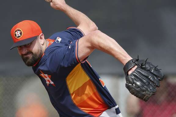 Houston Astros relief pitcher Pat Neshek (37) pitches during Houston Astros spring training at the Osceola County training facility, Tuesday, Feb. 24, 2015, in Kissimmee. ( Karen Warren / Houston Chronicle  )