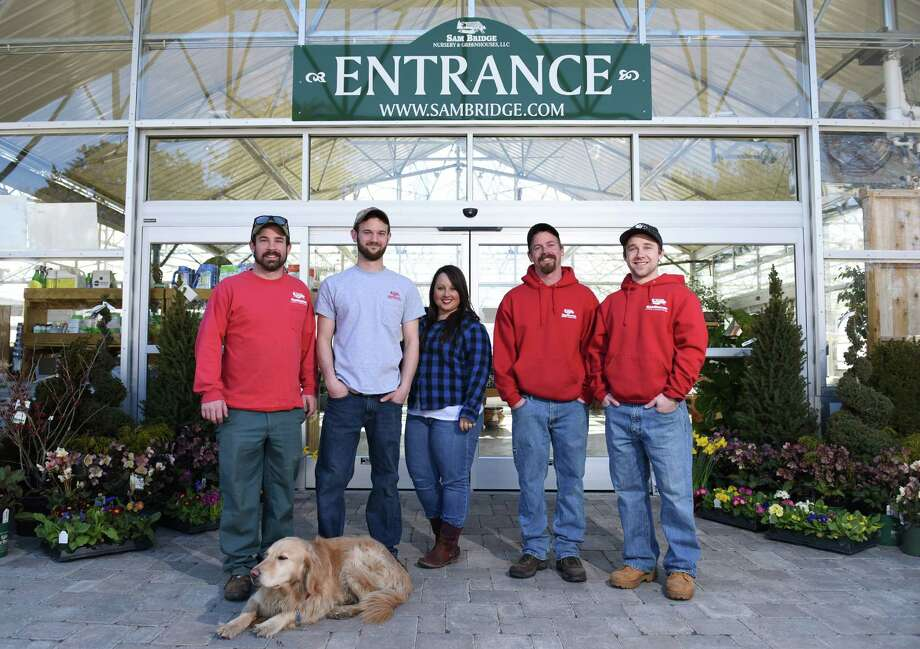 From left, Bill Palmer, Nick Bridge, Maggie Bridge, Rich Palmer Jr., and Sam Bridge IV, stand at the entrance of Sam Bridge Nurseries in Greenwich, Conn. Thursday, March 12, 2015.  The third-generation family business in the Greenwich upcountry is celebrating its 85th anniversary this year. Photo: Tyler Sizemore / Greenwich Time