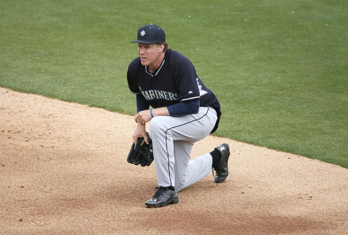 Actor Will Ferrell takes a knee while playing second base for the Seattle Mariners during the second inning of a spring training baseball game against the Oakland A's, Thursday, March 12, 2015, in Mesa, Ariz. Ferrell is filming a new special from Funny Or Die, in partnership with Major League Baseball, to air exclusively on HBO later this year. (AP Photo/Matt York)