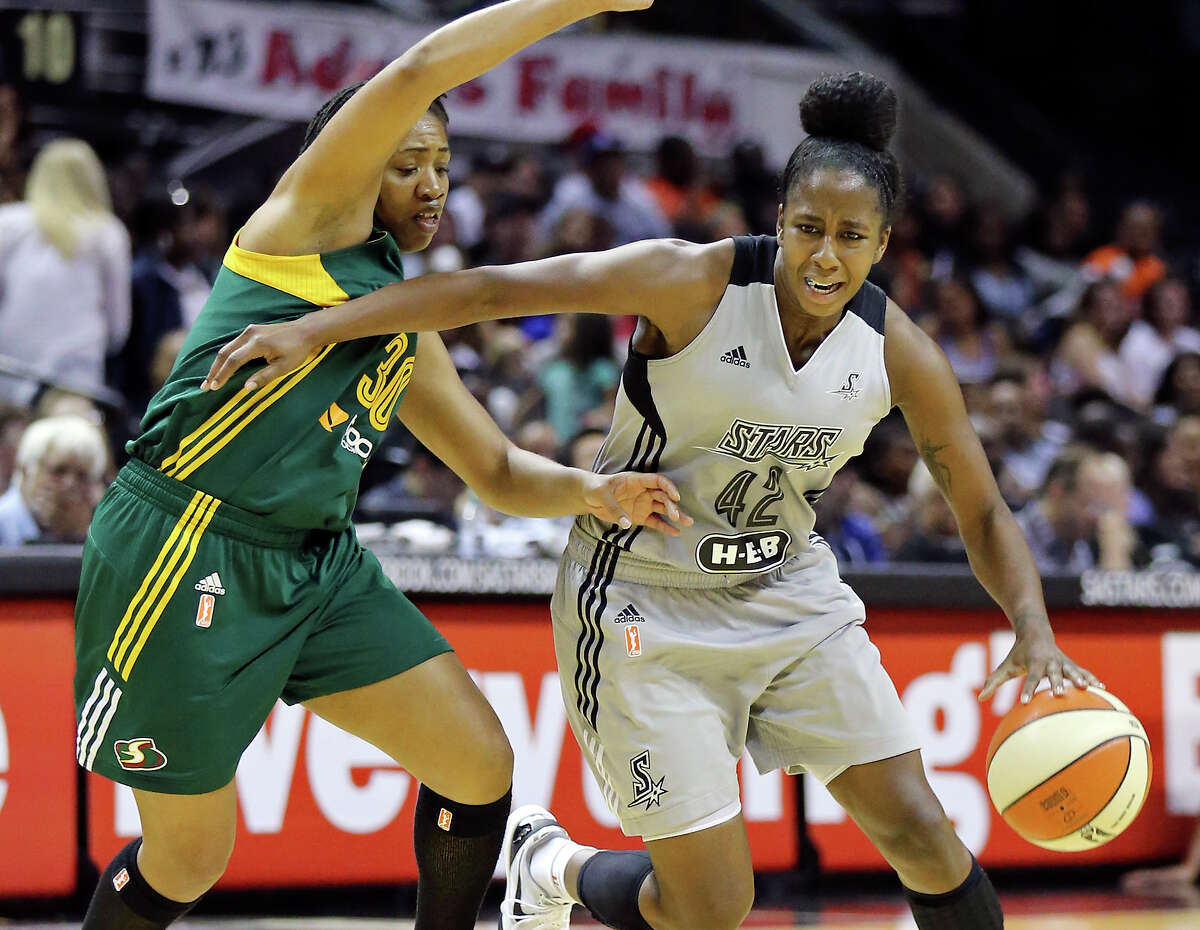 The Stars' Shenise Johnson looks for room around Seattle's Tanisha Wright during second half action Friday July 11, 2014 at the AT&T Center. The Storm won 88-67.