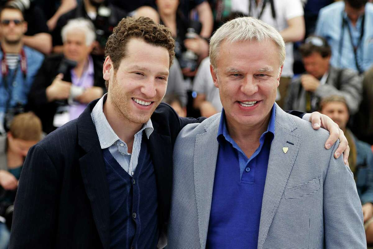 ADVANCE FOR WEEKEND EDITIONS, MARCH 7-8- FILE - In this May 16, 2014, file photo, director Gleb Polsky, left, and Slava Fetisov, the former captain of the Russian Red Army hockey team pose for photographers during a photo call for Red Army at the 67th international film festival in Cannes, southern France. Fetisov grudgingly promised 15 minutes to an American filmmaker who kept pestering the Hall of Fame defenseman to appear in a documentary about the Soviet Union as reflected through its dominant Red Army hockey team. Fetisov ended up spending 18 hours talking to first-time documentarian Gabe Polsky after realizing he had an opportunity to remind Western audiences of the smooth-skating, slick-passing Red Army's halcyon days, which certainly weren't defined by the Miracle on Ice. (AP Photo/Thibault Camus, File) ORG XMIT: LA104