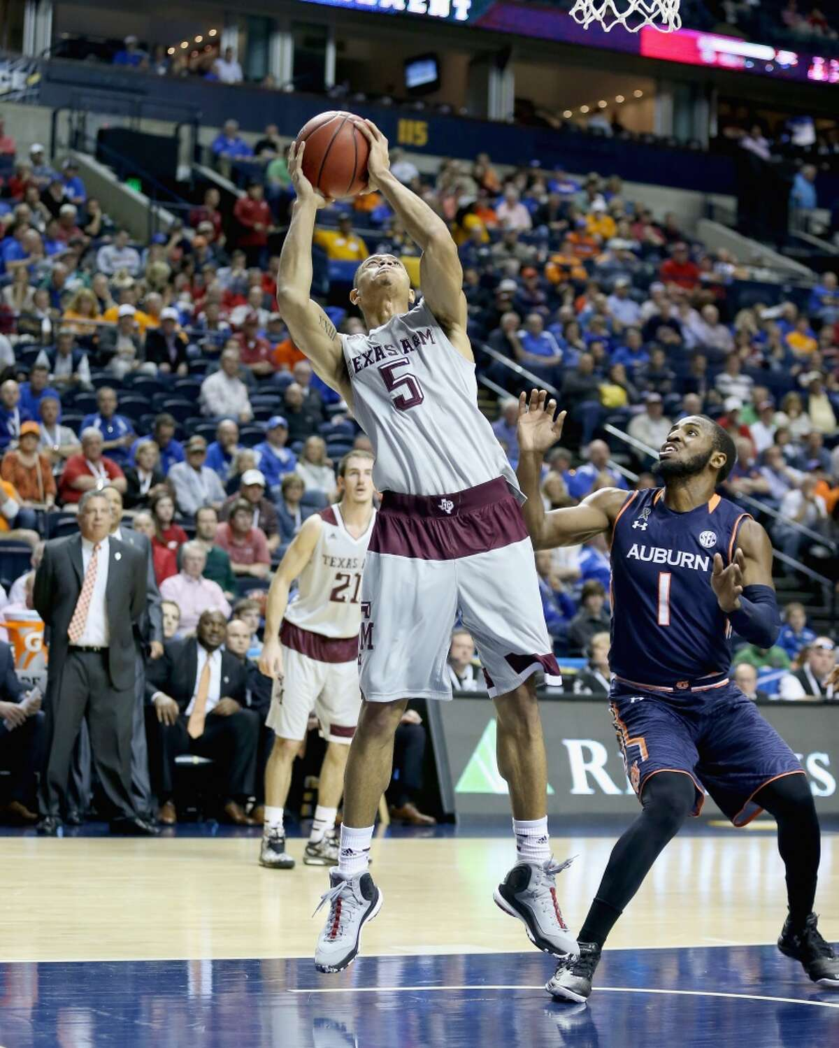 NASHVILLE, TN - MARCH 12: Jordan Green #5 of the Texas A&M Aggies shoots the ball against the Auburn Tigers during the second round game of the SEC Basketball Tournament at Bridgestone Arena on March 12, 2015 in Nashville, Tennessee. (Photo by Andy Lyons/Getty Images)