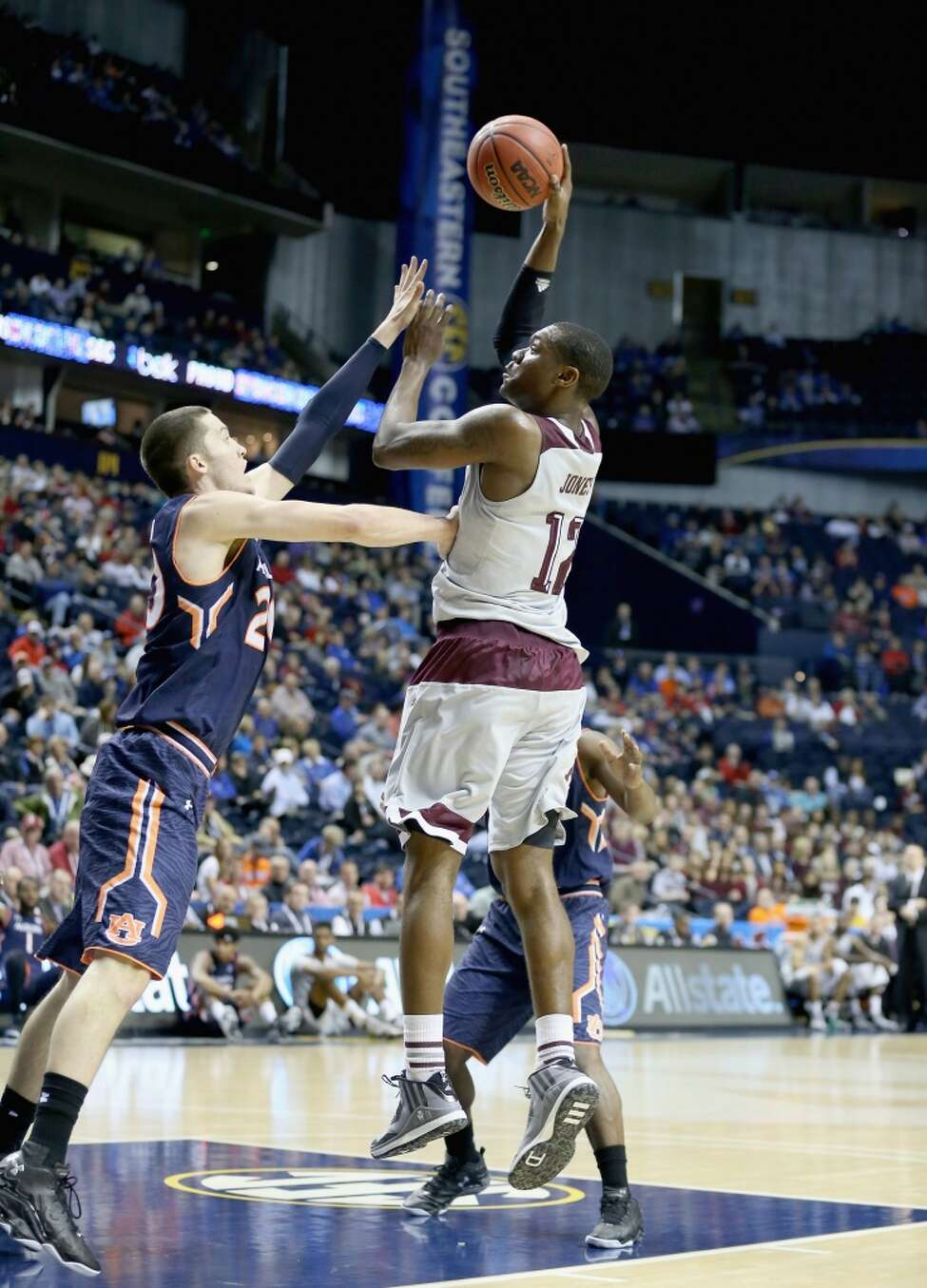 NASHVILLE, TN - MARCH 12: Jalen Jones #12 of the Texas A&M Aggies shoots the ball against the Auburn Tigers during the second round game of the SEC Basketball Tournament at Bridgestone Arena on March 12, 2015 in Nashville, Tennessee. (Photo by Andy Lyons/Getty Images)