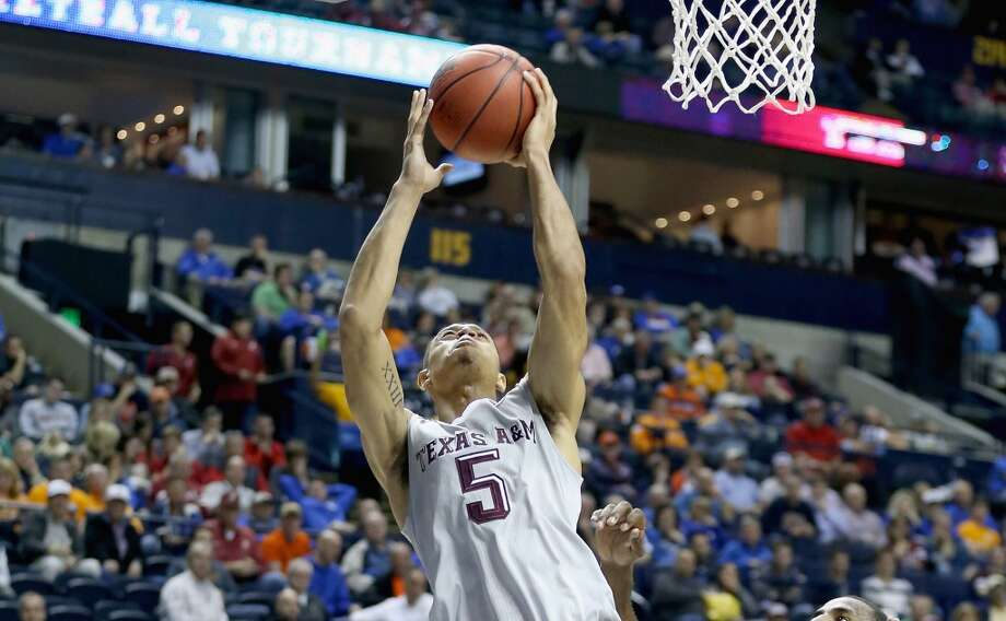SEC tournament: No. 13 Auburn 66, No. 5 Texas A&M 59Jordan Green #5 of the Texas A&M Aggies shoots the ball against the Auburn Tigers during the second round game of the SEC Basketball Tournament at Bridgestone Arena on March 12, 2015 in Nashville, Tennessee.  (Photo by Andy Lyons/Getty Images) Photo: Andy Lyons, Getty Images