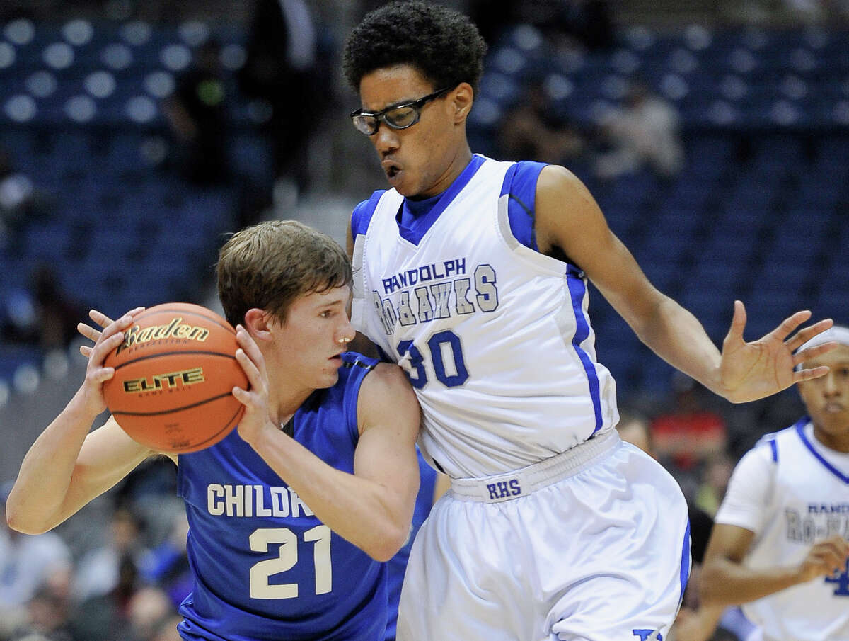 Randolph's Braelin Barnes (right) defends Childress' Kaden Keys during a Class state semifinal game on March 12, 2015, in San Antonio at the Alamodome. The Ro-Hawks won 31-29 to advance to their first state title game on Saturday.