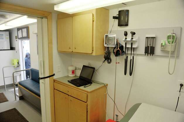 A view inside the examine room of the mobile health van during a press conference on Tuesday, March 10, 2015, in Troy, N.Y. The van, which is a self-contained medical office is part of a health program run by Commission on Economic Opportunity, Whitney Young Health and CDPHP. The van offers medical services to those in need and comes to the neighborhoods where people are dealing with various barriers to getting their health care needs met.  (Paul Buckowski / Times Union) Photo: PAUL BUCKOWSKI / 00030945A