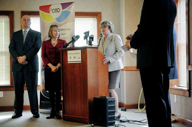 Katherine Maciol, at podium, president of the Commission on Economic Opportunity (CEO) talks about the mobile health van, as David Shippee, left, CEO of Whitney Young Health, and Rensselaer County Executive Kathy Jimino, center, look on, during a press conference on Tuesday, March 10, 2015, in Troy, N.Y. The van, which is a self-contained medical office is part of a health program run by Commission on Economic Opportunity, Whitney Young Health and CDPHP. The van offers medical services to those in need and comes to the neighborhoods where people are dealing with various barriers to getting their health care needs met.   (Paul Buckowski / Times Union) Photo: PAUL BUCKOWSKI / 00030945A