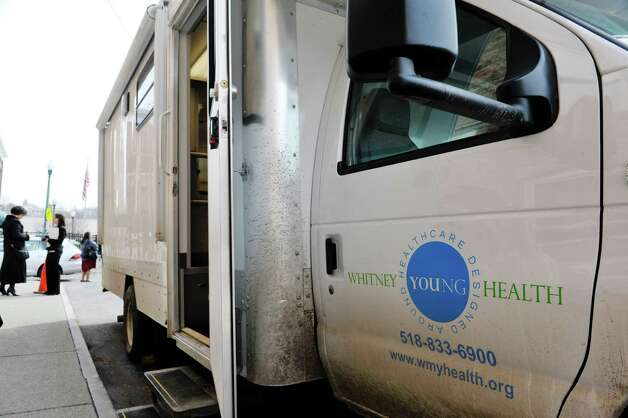 A view of the mobile health van during a press conference on Tuesday, March 10, 2015, in Troy, N.Y. The van, which is a self-contained medical office is part of a health program run by Commission on Economic Opportunity, Whitney Young Health and CDPHP. The van offers medical services to those in need and comes to the neighborhoods where people are dealing with various barriers to getting their health care needs met.  (Paul Buckowski / Times Union) Photo: PAUL BUCKOWSKI / 00030945A
