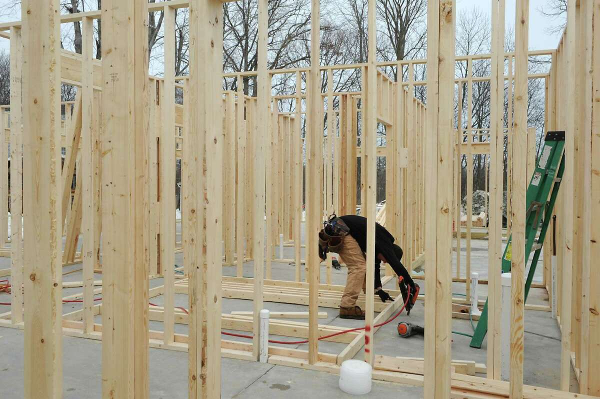 Construction is underway for more homes at the Canterbury Crossing development on Tuesday, March 10, 2015 in Latham, N.Y. (Lori Van Buren / Times Union)