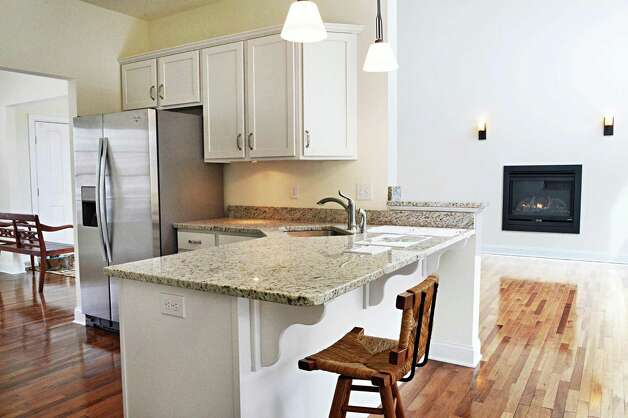 The kitchen of a new Barbera home on Stonecrest Drive in the Stone Crest Development Tuesday March 10, 2015 in Halfmoon, NY.  (John Carl D'Annibale / Times Union) Photo: John  Carl D'Annibale / 00030924A