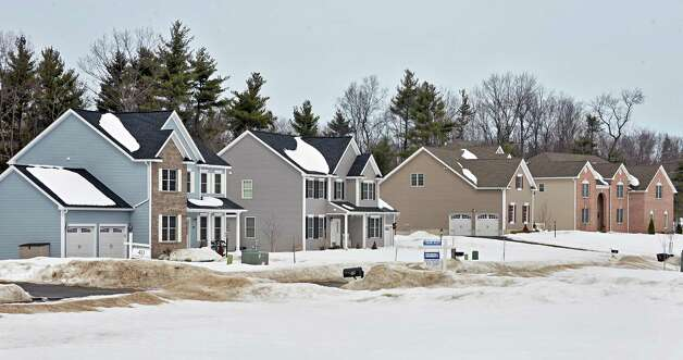 New homes along Stonecrest Drive Tuesday March 10, 2015 in Halfmoon, NY.  (John Carl D'Annibale / Times Union) Photo: John Carl D'Annibale / 00030924A