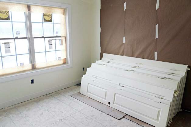 New windows and building materials  inside a new home under construction on Barn Owl Place in the Stone Crest development Tuesday March 10, 2015 in Halfmoon, NY.  (John Carl D'Annibale / Times Union) Photo: John Carl D'Annibale / 00030924A