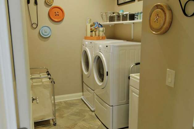 A view of the laundry room inside a two-bedroom, two-bath unit at the Mill Hollow condominiums on Tuesday, March 10, 2015, in Guilderland, N.Y.  (Paul Buckowski / Times Union) Photo: PAUL BUCKOWSKI / 00030927A
