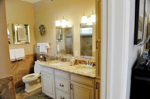 A view of the master bath with two sinks inside a two-bedroom, two-bath unit at the Mill Hollow condominiums on Tuesday, March 10, 2015, in Guilderland, N.Y.  (Paul Buckowski / Times Union) Photo: PAUL BUCKOWSKI / 00030927A