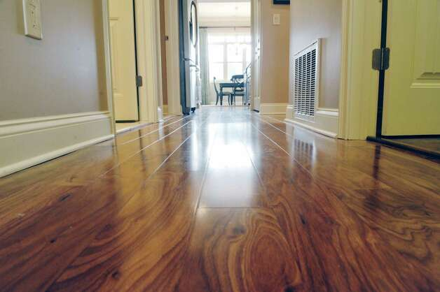 A view looking down the hallway inside a two-bedroom, two-bath unit at the Mill Hollow condominiums on Tuesday, March 10, 2015, in Guilderland, N.Y.  The unit has engineered hardwood floors throughout.  (Paul Buckowski / Times Union) Photo: PAUL BUCKOWSKI / 00030927A