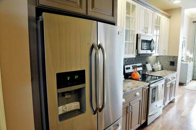 A view of the kitchen inside a two-bedroom, two-bath unit at the Mill Hollow condominiums on Tuesday, March 10, 2015, in Guilderland, N.Y.  (Paul Buckowski / Times Union) Photo: PAUL BUCKOWSKI / 00030927A