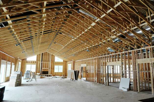 A view inside the club house of what will be the great room at Mill Hollow condominiums on Tuesday, March 10, 2015, in Guilderland, N.Y.  The great room will feature a fire place, leather seating and a bar area.  The club house will also have a workout room and an 15 person theater.  (Paul Buckowski / Times Union) Photo: PAUL BUCKOWSKI / 00030927A