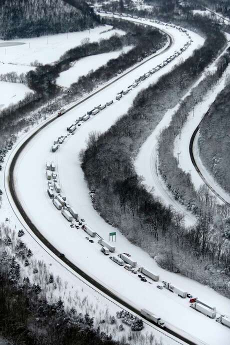 Vehicles were stranded last week on I-65 in Kentucky. More evidence is pointing to global warming causing odd winter and summer patterns. Photo: Pat McDonogh, MBO / The Courier-Journal