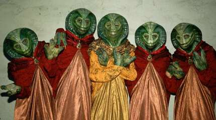 Extras portraying alien creatures on the hit TV show Star Trek-The Next Generation pose during a break in filming on the Hollywood, California, Paramount Studios set. (Photo by George Rose/Getty Images)